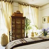 An antique cupboard in a bedroom