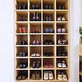 A shoe shelf built into a wall niche