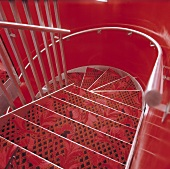 A red stairway - metal stairs covered with a red carpet