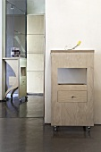 A rolling cupboard in an anteroom with a polished screed floor