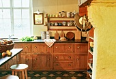 A kitchen in a farm house - a kitchen counter with old wooden drawers