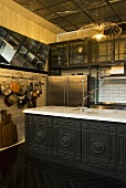 A traditional open-plan kitchen and a kitchen counter with artificial lighting