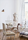 Assorted chairs and dress mannequin at the window