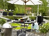 Breakfast under a sun umbrella on a terrace