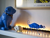 Blue animal figures on a white shelf