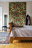 Bedroom with antique wooden bed and wall hanging with floral pattern and chair in Art Nouveau style