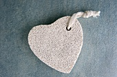 A heart-shaped pumice stone (close-up)