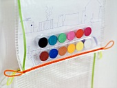 Drawing and colorful water color paint set in plastic shrink wrap