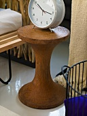 Alarm clock on a rustic wooden side table