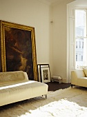 Sitting room with neutral tones and large painting