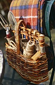 Wooden storage basket filled with gardening tools