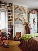 Books in shelving in teenagers bedroom