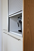 Storage with shutter in fitted kitchen unit