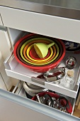 Cookware in storage drawer
