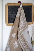 Towel on hook of chalkboard