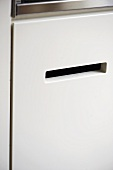 Recessed handle in fitted unit