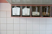 Plastic storage boxes in shelf compartments