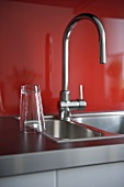 Stainless steel kitchen sink and chrome tap fitting