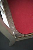 Red seat mat on wooden chair