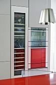 Integral oven and wine cooler in modern kitchen