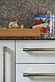 Wooden chopping board on kitchen worktop