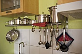 Cooking saucepans on steel shelf