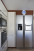 Modern kitchen with white units and integral ovens
