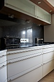 Modern kitchen with white fitted units