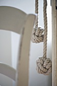 Two pieces of rope ending in knots