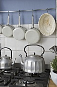 Old fashioned style kettles on gas hob