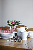Tableware and cutlery on wooden table