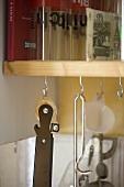 Kitchen utensils hanging from hooks