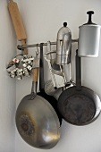 Kitchenware hanging from steel bar