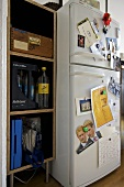 Built in shelving unit next to fridge