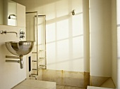 Wall mounted stainless steel washbasin in ensuite bathroom