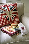 Cushions with Union Jack motifs on upholstered armchair