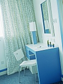 Hotel bedroom with retro styled blue and white dressing table