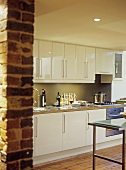 White fitted units in kitchen