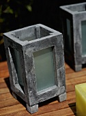 A detail of stone and glass candle holders for use outside