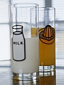 Glasses filled with milk and orange juice