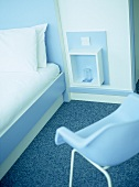 Hotel bedroom with blue and white retro style furniture.