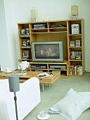 Sitting room with flat screen television and media storage unit.