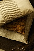 Cushions in covered in elegant shiny fabric