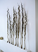 Close up detail of ornamental dried grasses on white mantelpiece.