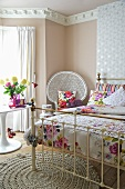 A traditional bedroom with a brass bedstead, a crocheted rug and a bedside table