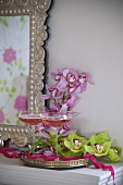 Filled champagne glasses and orchid flowers on a silver tray