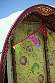A circus caravan decorated with bunting