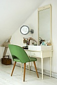 50s style green chair in front of a dressing table with mirror