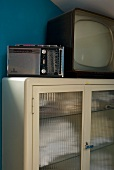 50s style radio and TV on a display cabinet