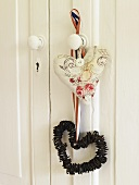 Heart shapes made of assorted materials hanging on a door knob